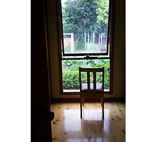 Chair at window looking out Photographic Print