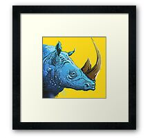 Blue Rhino on Yellow Background Framed Print