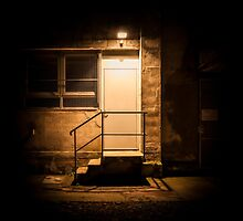 Stairs and door illuminated in the night by enolabrain