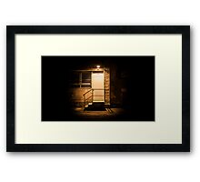 Stairs and door illuminated in the night Framed Print