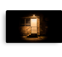 Stairs and door illuminated in the night Canvas Print