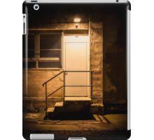 Stairs and door illuminated in the night iPad Case/Skin