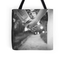 Groom holding hands with bride black and white wedding photograph Tote Bag