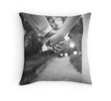 Groom holding hands with bride black and white wedding photograph Throw Pillow