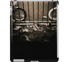 Childrens bicycles against park railings  black and white sepia tone 35mm silver gelatin analog photo iPad Case/Skin