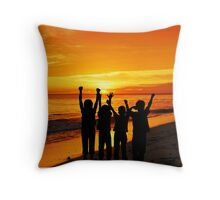 Children silhouettes on a  sunset beach Throw Pillow