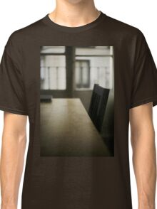 Wooden table desk and chair in empty room with window behind in beige brown colors artistic color digital photograph Classic T-Shirt