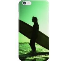 Surfer carrying surfboard in surreal silhouette in green in sea ocean water by beach 35mm analog xpro cross lomo lca photo iPhone Case/Skin