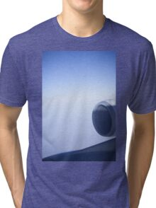 Jumbo jet airplane wing engine in flight flying over blue sky photo Tri-blend T-Shirt