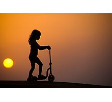 Child on a scooter Photographic Print
