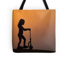 Child on a scooter Tote Bag
