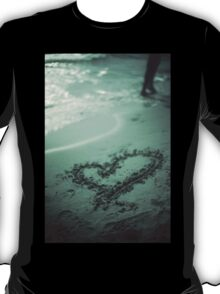 Love heart drawn on beach sand at low tide with ocean sea T-Shirt