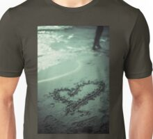Love heart drawn on beach sand at low tide with ocean sea Unisex T-Shirt