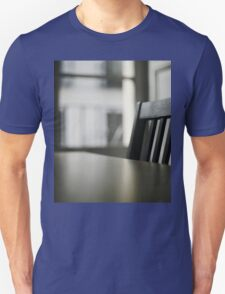 Wooden table desk and chair in empty room with window behind in beige brown colors artistic color digital photo Unisex T-Shirt