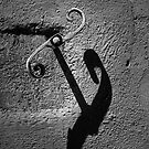 Hook on wall by Patrick Reinquin