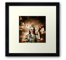 Evil surgeon clown juggling bloody knives outside Framed Print