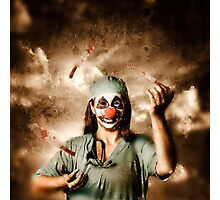 Evil surgeon clown juggling bloody knives outside Photographic Print