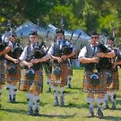 Stylized photo of pipe and drum band returning from their performance at the San Diego Scottish Highland Games & Gathering of Clans in Vista, CA US. by NaturaLight