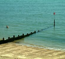 Taking a dip.... Dovercourt, Essex, UK. by newbeltane