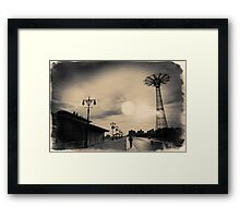A man walking along the Coney Island boardwalk at sunset with the Parachute Jump in a sepia - colored postcard Framed Print