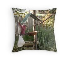Galah landing on the feeder Throw Pillow