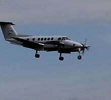 Commuter Plane Linding by Robin M. Monk