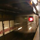 Blur of approaching subway by cascoly