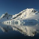 Antarctica mountain, mirrored in still seas by cascoly