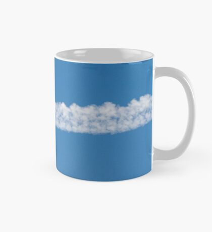 wake of the plane in the clouds Mug