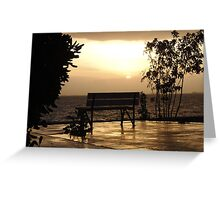 A lonely bench on a rainy sunset Greeting Card