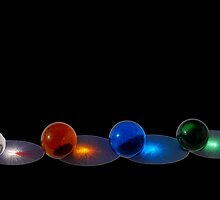 Sunlit Marbles on Black by Robert Goulet