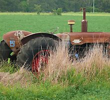 Tractor in the field by Tim Everding