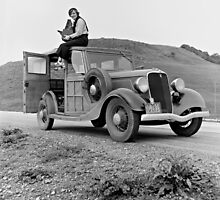 Dorothea Lange atop automobile in California. The car is a 1933 Ford Model C, 4 door Wagon. by Adam Asar