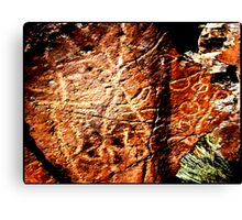 Pictographs or rock scratches Canvas Print