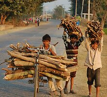Heavy loads and young faces, Nepal by Peter Gostelow
