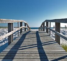 Boardwalk leading to the beach by Jeff Hathaway
