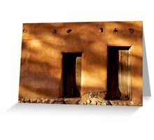 Two wooden doors on an adobe building in Santa Fe New Mexico Greeting Card