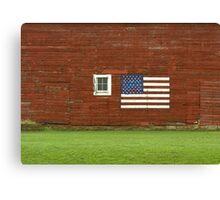 Flag on a rural farmhouse wall Canvas Print