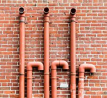 Red Pipes on Red Brick by dbvirago