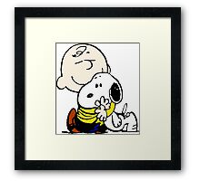 Charlie Brown hugs Snoopy Framed Print