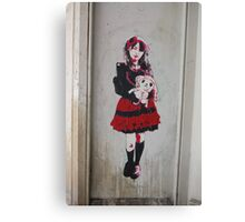 girl holding a doll Canvas Print