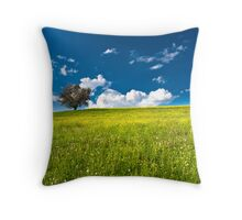 single tree on bright meadow Throw Pillow