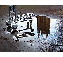 Luggage trolley and tower in a puddle (London) Photographic Print