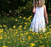 Through The Flowers She Goes by Elaine Harriott