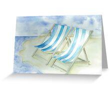 Blue deckchairs on a summer beach Greeting Card