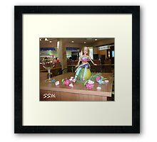 The blond doll Framed Print