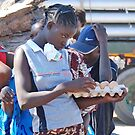 The Zambian egg seller,  Kazangula Ferry Crossing, Zambia, Africa by Adrian Paul