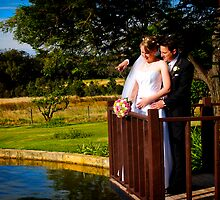 Bride and Groom on Pond by Peter Evans