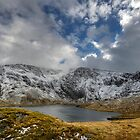 Llyn Idwal with a scattering of snow by Owen Burke