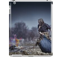 Senior rural woman burning fallen leaves iPad Case/Skin